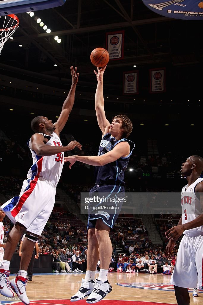 Kyrylo Fesenko #44 of the Utah Jazz puts a shot up over Jason Maxiell #54 of the Detroit Pistons during the game at The Palace of Auburn Hills on October 12, 2007 in Auburn Hills, Michigan. The Jazz won 100-85.