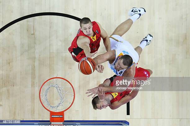 Kyrylo Fesenko of Ukraine drives to the basket against Axel Hervelle of Belgium during the FIBA EuroBasket 2015 Group D basketball match between...