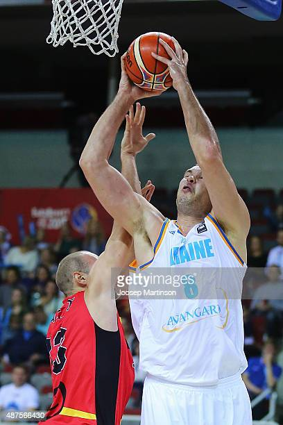 Kyrylo Fesenko of Ukraine drives to the basket against PierreAntoine Gillet of Belgium during the FIBA EuroBasket 2015 Group D basketball match...