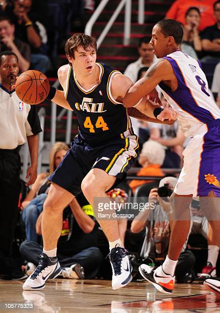 Kyrylo Fesenko the Utah Jazz moves the ball against Channing Frye of the Phoenix Suns during a game on October 12 2010 at the US Airways Center in...