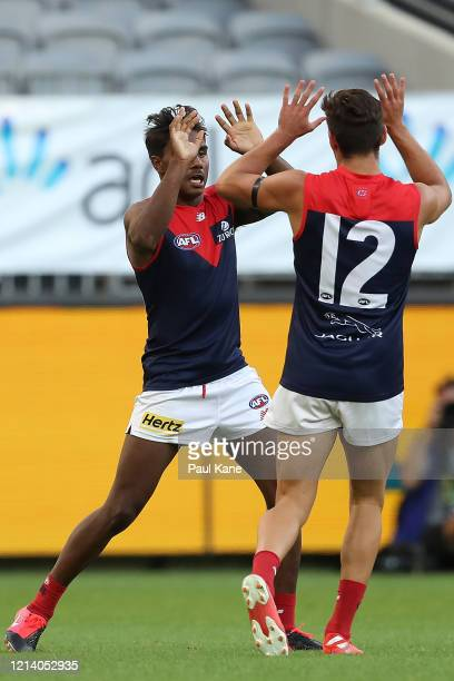 Kysaiah Pickett and Toby Bedford of the Demons celebrate a goal during the round 1 AFL match between the West Coast Eagles and the Melbourne Demons...