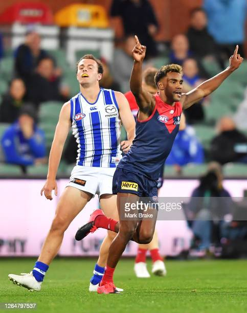 Kysaiah Pickett of the Demons celebrates a goal during the round 11 AFL match between the Melbourne Demons and the North Melbourne Kangaroos at...