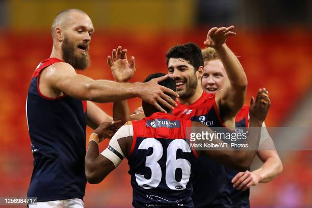 Kysaiah Pickett of the Demons celebrates with his team mates after kicking a goal during the round 7 AFL match between the Hawthorn Hawks and the...
