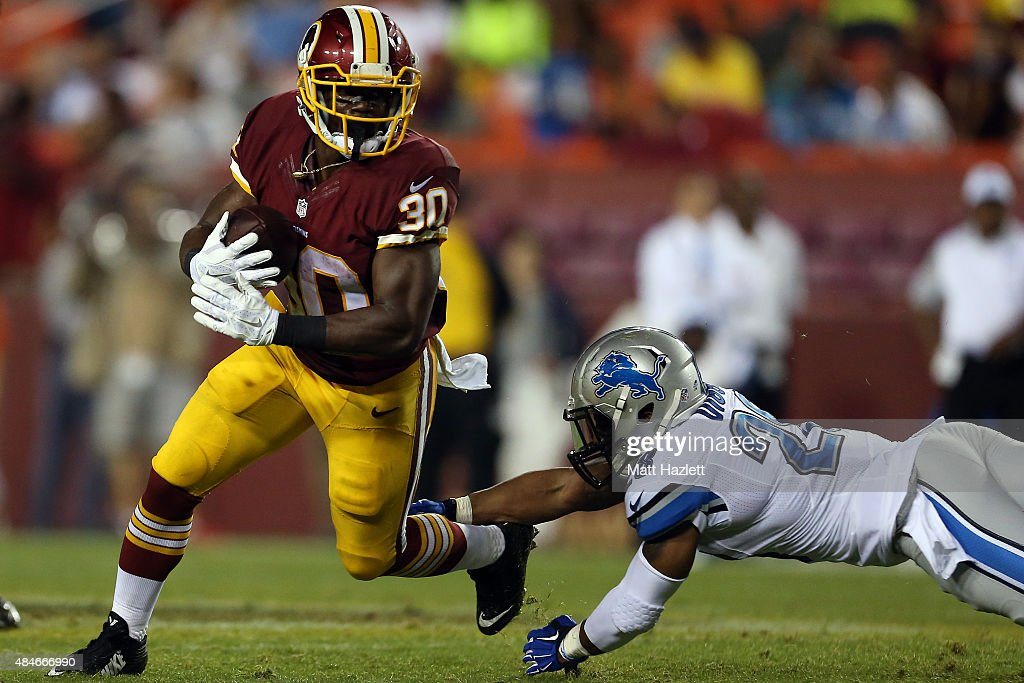 Kyshoen Jarrett #30 of the Washington Redskins breaks past Quandre Diggs #28 of the Detroit Lions during a preseason game at FedEx Field on August 20, 2015 in Landover, Maryland.