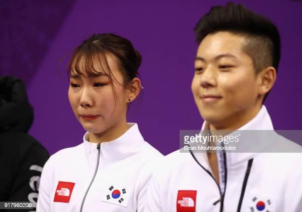 Kyueun Kim and Alex Kang Chan Kam of Korea react to their score during the Pair Skating Short Program on day five of the PyeongChang 2018 Winter...