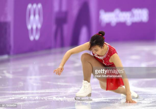 Kyueun Kim of Korea falls during her routine with partner Alex Kang Chan Kam of Korea during the Pair Skating Short Program on day five of the...