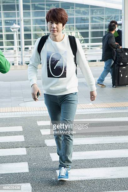 Kyuhyun of South Korean boy band Super Junior is seen on departure at Incheon International Airport on March 28, 2015 in Incheon, South Korea.