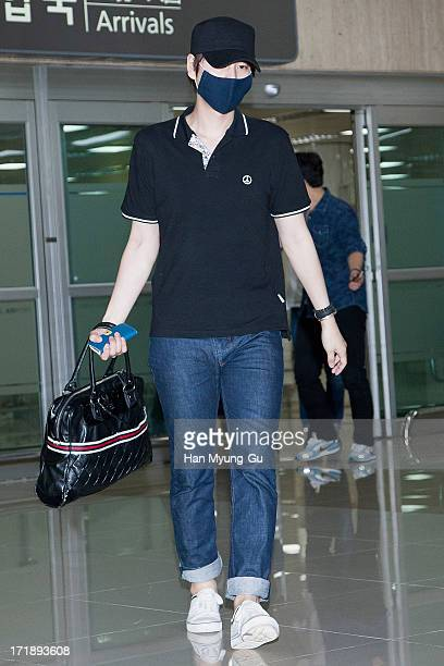 Kyuhyun of South Korean boy band Super Junior is seen upon arrival at Gimpo International Airport on June 29 2013 in Seoul South Korea