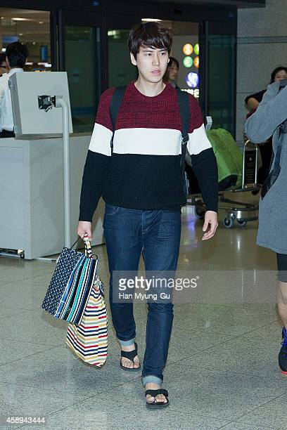 Kyuhyun of South Korean boy band Super Junior is seen upon arrival at Incheon International Airport on November 12, 2014 in Incheon, South Korea.
