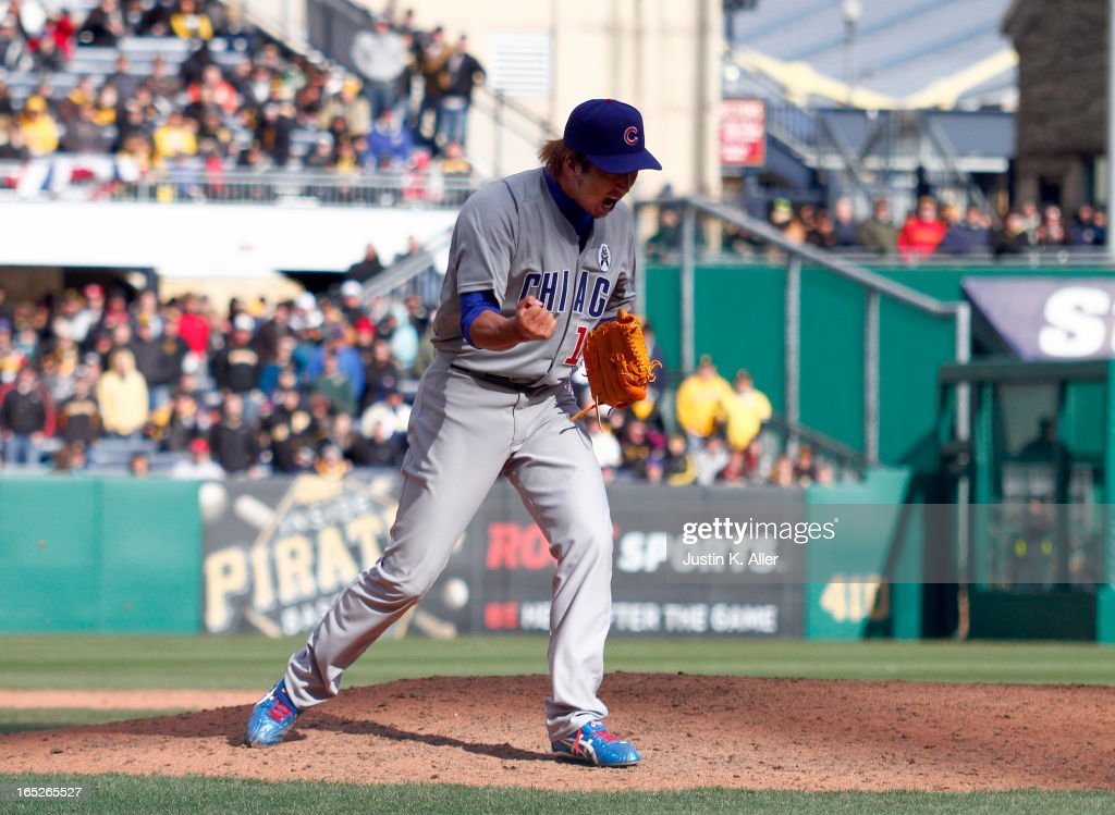 Kyuji Fujikawa #11 of the Chicago Cubs celebrates after closing out the game against the Pittsburgh Pirates during the opening day game on April 1, 2013 at PNC Park in Pittsburgh, Pennsylvania. The Cubs defeated the Pirates 3-1.