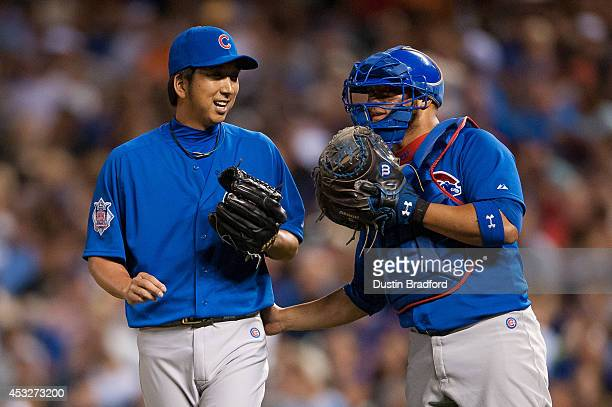 Kyuji Fujikawa of the Chicago Cubs has a word with Welington Castillo in the sixth inning of a game against the Colorado Rockies at Coors Field on...