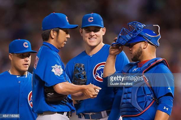Kyuji Fujikawa of the Chicago Cubs has a word with Welington Castillo as he makes a relief appearance in the sixth inning of a game against the...