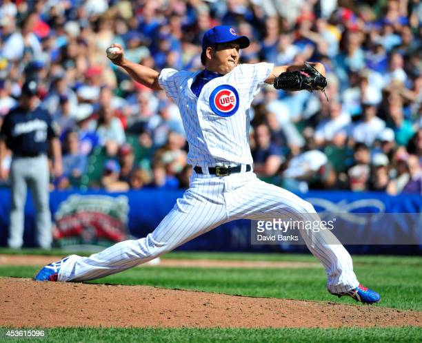 Kyuji Fujikawa of the Chicago Cubs pitches against the Milwaukee Brewers during the eighth inning on August 14 2014 at Wrigley Field in Chicago...