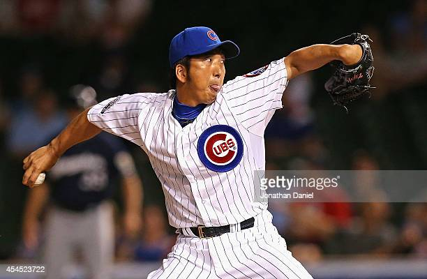 Kyuji Fujikawa of the Chicago Cubs pitches for a save in th 9th inning against the Milwaukee Brewers at Wrigley Field on September 2 2014 in Chicago...