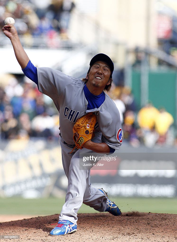 Kyuji Fujikawa #11 of the Chicago Cubs pitches in the ninth inning against the Pittsburgh Pirates during the opening day game on April 1, 2013 at PNC Park in Pittsburgh, Pennsylvania. The Cubs defeated the Pirates 3-1.