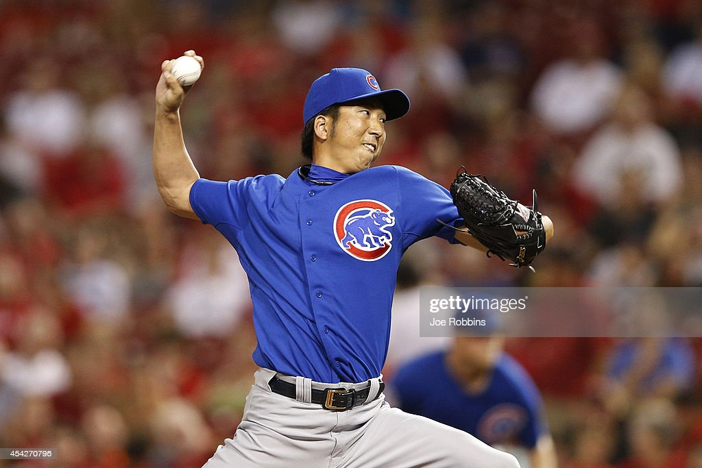 Kyuji Fujikawa #11 of the Chicago Cubs pitches in the seventh inning of the game against the Cincinnati Reds at Great American Ball Park on August 27, 2014 in Cincinnati, Ohio. The Reds won 7-5.