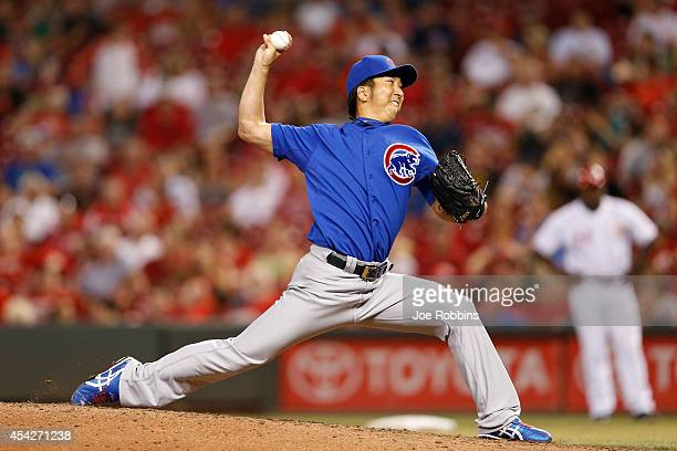 Kyuji Fujikawa of the Chicago Cubs pitches in the seventh inning of the game against the Cincinnati Reds at Great American Ball Park on August 27...