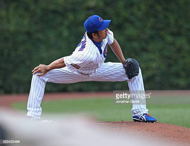 Kyuji Fujikawa of the Chicago Cubs stretches in the bullpen during a game against the Tampa Bay Rays at Wrigley Field on August 9 2014 in Chicago...