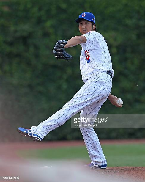 Kyuji Fujikawa of the Chicago Cubs warmsup in the bull pen during a game against the Tampa Bay Rays at Wrigley Field on August 9 2014 in Chicago...