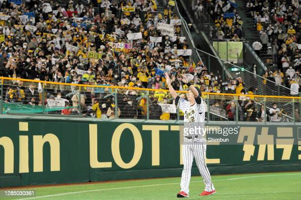 Kyuji Fujikawa of the Hanshin Tigers applauds fans after his retirement ceremony after the game against Yomiuri Giants at the Hanshin Koshien Stadium...