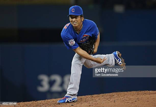 Kyuji Fujikawa of the Toronto Blue Jays delivers a pitch in the seventh inning during MLB game action against the Chicago Cubs on September 10 2014...