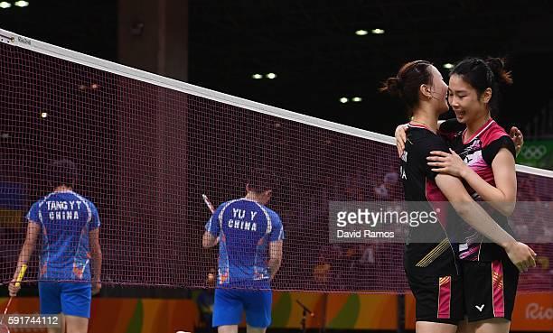 Kyung Eun Jung and Seung Chan Shin of Republic of Korea celebrate defeating Yu Yang and Yuanting Tang of China during the Women's Badminton Double...