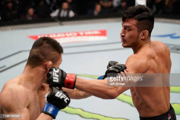 Kyung Ho Kang of South Korea punches Liu Pingyuan of China in their bantamweight fight during the UFC Fight Night event at Sajik Arena 3 on December...