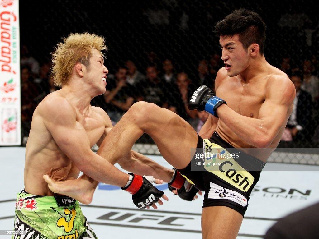 Kyung Ho Kang throws a kick on Michinori Tanaka in their bantamweight bout during the UFC Fight Night event inside the Saitama Arena on September 20, 2014 in Saitama, Japan.