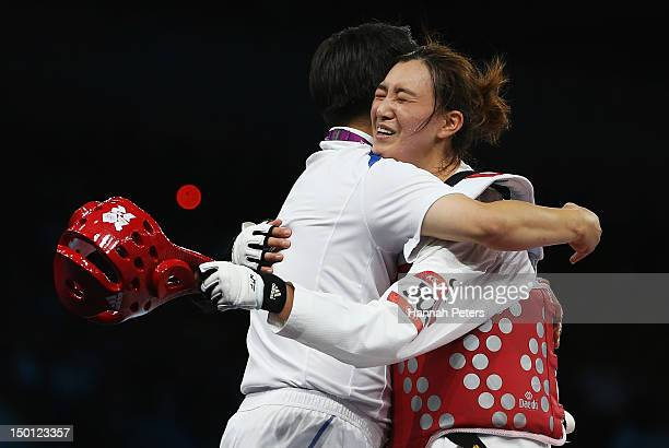 Kyung Seon Hwang of Korea celebrates winning the Gold medal in the Women's 67kg Taekwondo Gold Medal Final against Nur Tatar of Turkey on Day 14 of...