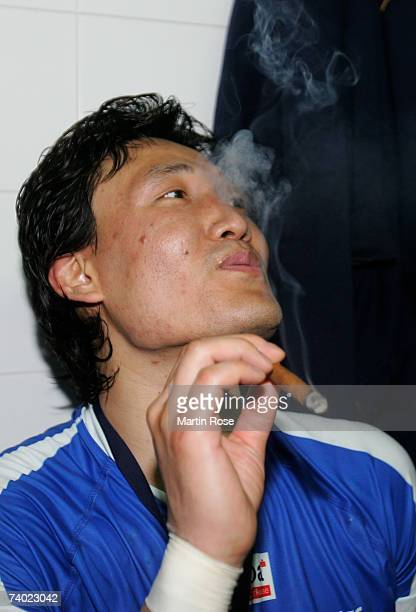 Kyung Shin Yoon of Hamburg smokes a cigar after the European Cup Winners Cup Final second leg match between Ademar Leon and HSV Handball at the...