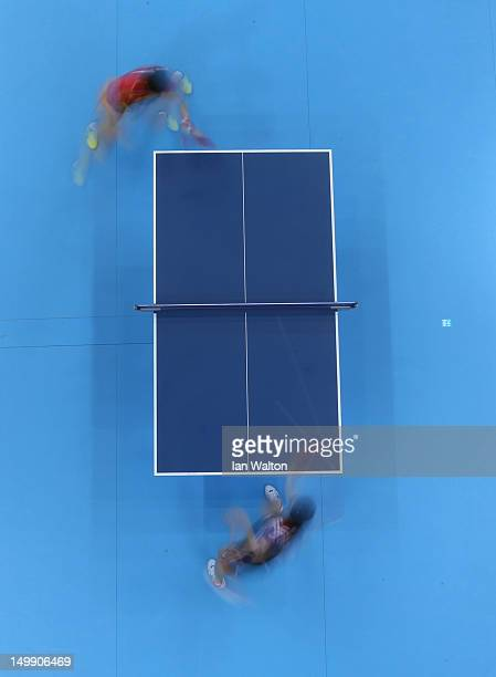 Kyungah Kim of Korea in action against Ning Ding of China during the women's team table tennis semifinals on Day 10 of the London 2012 Olympic Games...