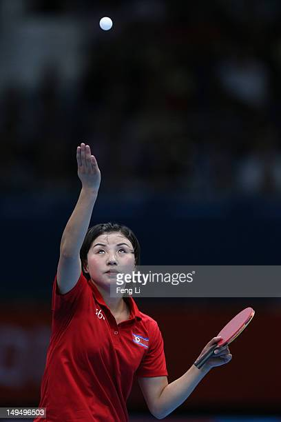 Kyungah Kim of Korea serves in her Women's Singles Table Tennis third round match against Jia Liu of Austria on Day 2 of the London 2012 Olympic...