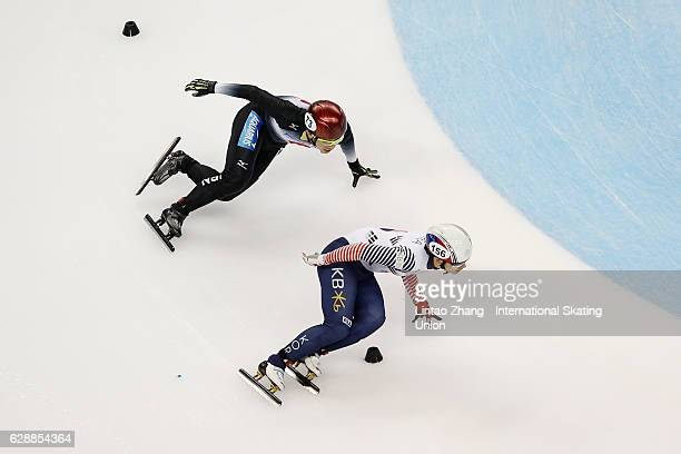Kyunghwan Hong of South Korea and Yoshiaki Oguro of Japan competes in the Men 500m semifinal on day one of the ISU World Cup Short Track speed...