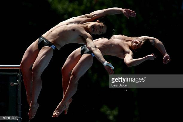 Kyungmin Kwon and Kwanhoon Cho of South Korea compete in the Men's 10m Synchro Platform Final during the 13th FINA World Championships at the Stadio...