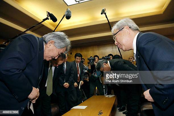 Kyushu Electric Power Co President Michiaki Uriu and Genkai city mayor Hideo Kishimoto bow after their meeting on March 18 2015 in Genkai Saga Japan...