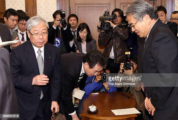 Kyushu Electric Power Co President Michiaki Uriu leaves a room after a meeting with Saga Prefecture vice governor Hiroki Sakai on March 18 2015 in...
