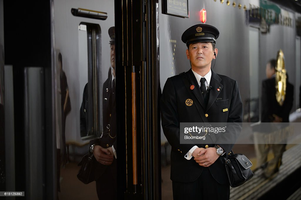 A Kyushu Railway Co. employee waits for passengers outside the company's Seven Stars in Kyushu luxury train at Hakata Station in Fukuoka, Japan, on Tuesday, Oct. 11, 2016.JR Kyushu, the state-owned bullet-train operator seeking to raise as much as 416 billion yen ($4 billion) in an initial public offering, plans to reduce its reliance on Japan by investing in residential and office properties in Southeast Asia, its chairman said in an interview. Photographer: Akio Kon/Bloomberg via Getty Images