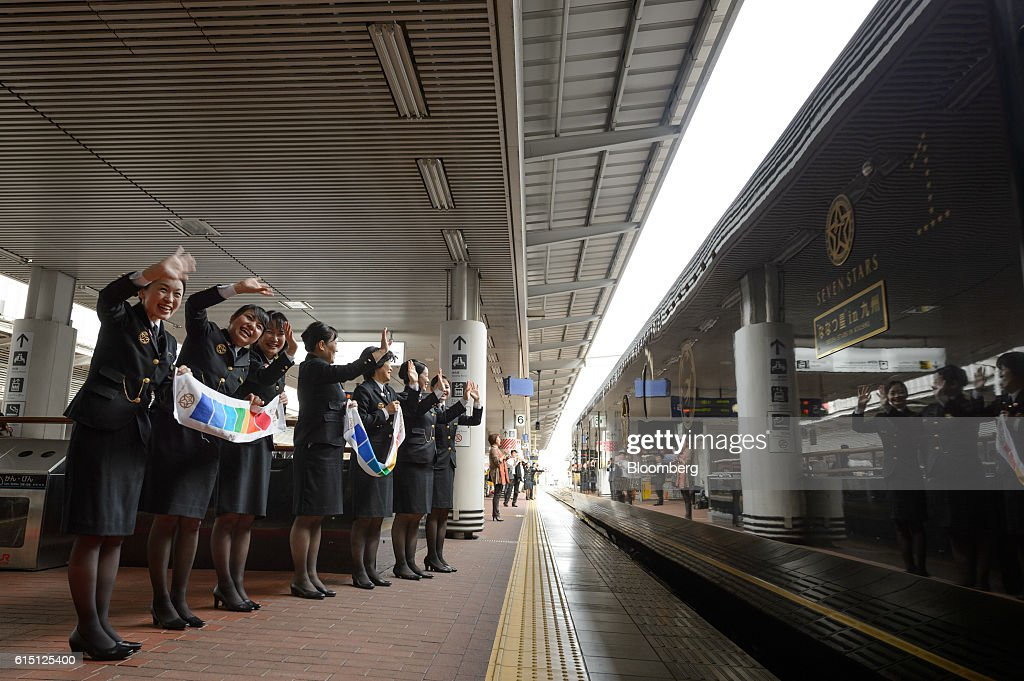 Kyushu Railway Co. employees wave off the company's Seven Stars in Kyushu luxury train at Hakata Station in Fukuoka, Fukuoka Prefecture, Japan, on Tuesday, Oct. 11, 2016. JR Kyushu, the state-owned bullet-train operator seeking to raise as much as 416 billion yen ($4 billion) in an initial public offering, plans to reduce its reliance on Japan by investing in residential and office properties in Southeast Asia, its chairman said in an interview. Photographer: Akio Kon/Bloomberg via Getty Images