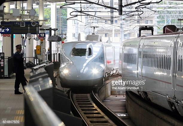 Kyushu Shinkansen bullet train approaches to Kumamoto Station for a test drive eyeing for the operation restart on April 23 2016 in Kumamoto Japan...