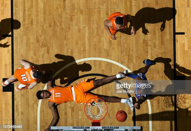 Kyvon Davenport of the Memphis Tigers drives to the basket for a layup against Kyle Alexander of the Tennessee Volunteers on December 15 2018 at...