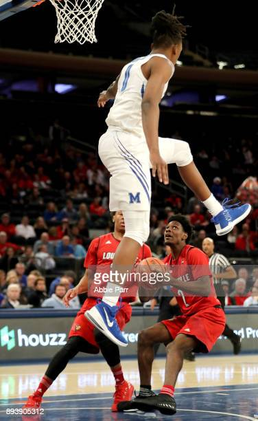 Kyvon Davenport of the Memphis Tigers goes to block a shot by Darius Perry of the Louisville Cardinals in the second half during their Gotham Classic...