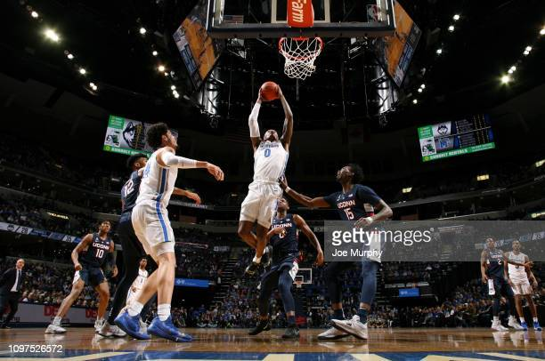Kyvon Davenport of the Memphis Tigers goes up for a dunk against Sidney Wilson of the Connecticut Huskies on February 10 2019 at FedExForum in...