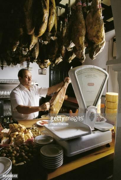 La Albariza bar Seville A cook slicing 'jamon serrano' in a bar