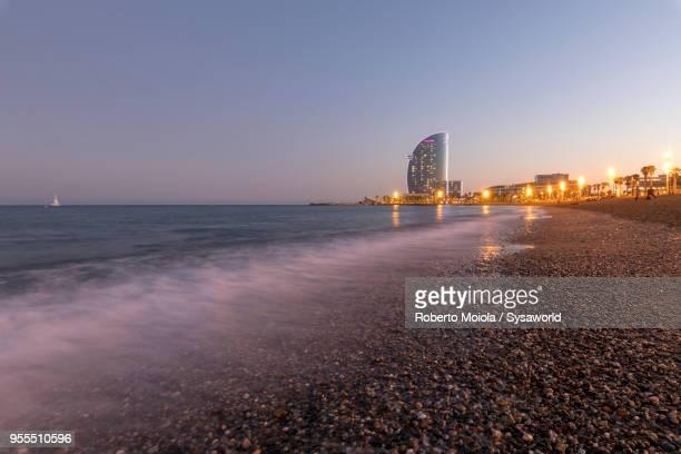 la barceloneta beach, barcelona, spain - la barceloneta stock pictures, royalty-free photos & images