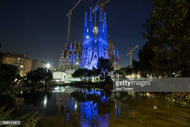 La Basilica de la Sagrada Familia is illuminated in blue to mark World Autism Awareness Day on April 2 2015 in Barcelona Spain