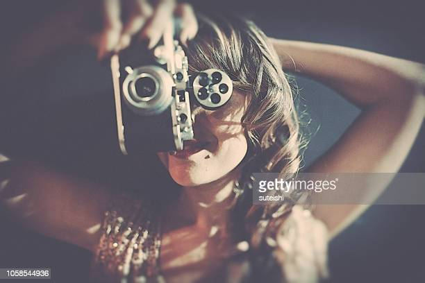 la belle with the old camera - diva human role stock photos and pictures