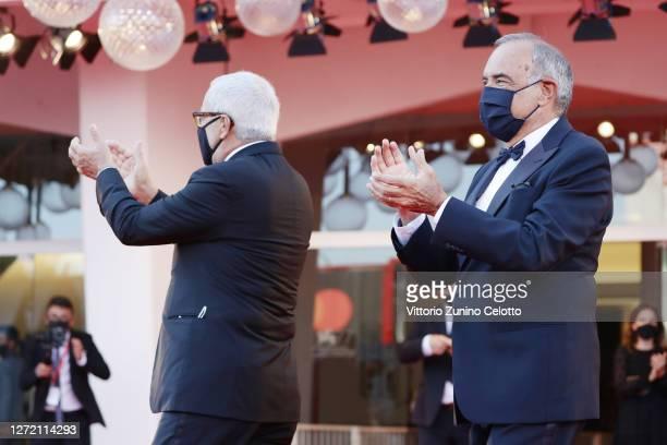 La Biennale Di Venezia President Roberto Cicutto and Director of 77 Mostra Internazionale d'Arte Cinematografica Alberto Barbera cheers the...