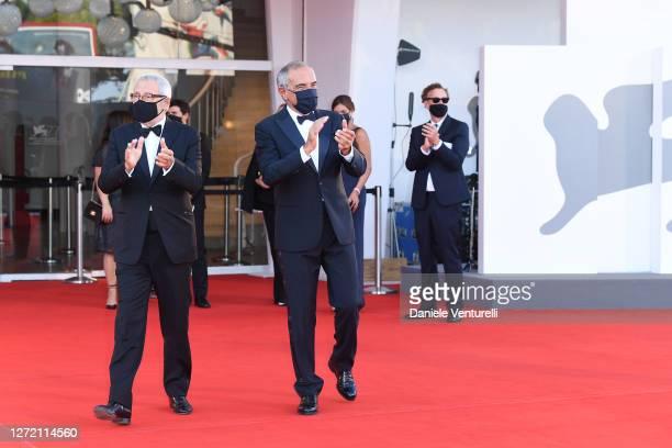 La Biennale Di Venezia President Roberto Cicutto and Director of 77 Mostra Internazionale d'Arte Cinematografica Alberto Barbera cheer the...