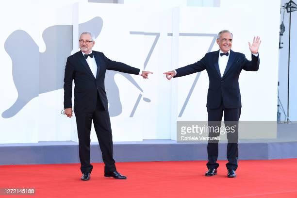 La Biennale Di Venezia President Roberto Cicutto and Director of 77 Mostra Internazionale d'Arte Cinematografica Alberto Barbera walk the red carpet...