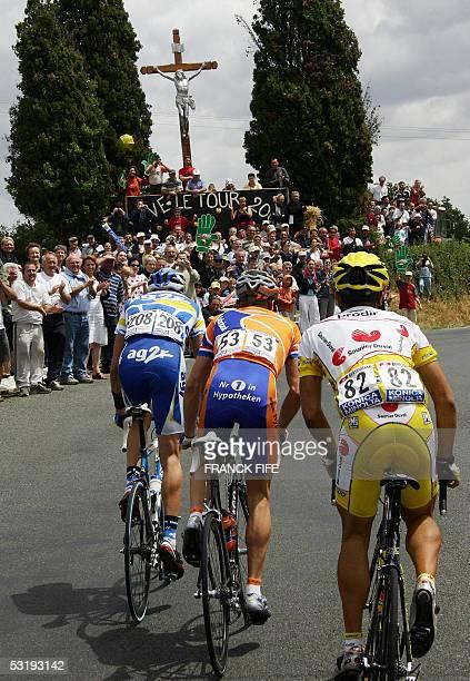 La Chataigneraie, France: Frenchman Nicolas Portal , Dutch Erik Dekker and Spaniard David Canada ride during their breakaway in the 92nd Tour de...